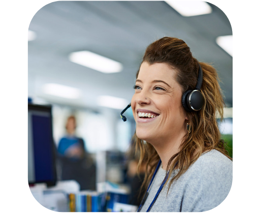 woman smiling in call centre